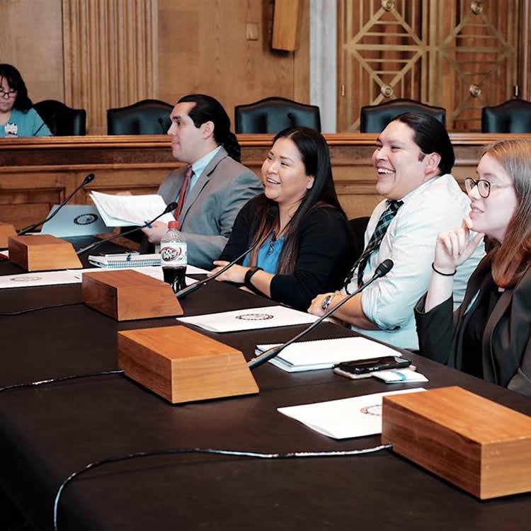 American Indian students laughing and discussing in panel format on USET program