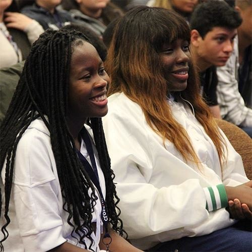 Smiling female students learning