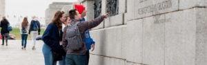 High school students exploring WWII memorial